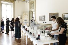 Lucia and Liza, WHAT'S MORE ALIVE THAN YOU™ designers, are tasting the shoes of the other designers #MFW #SS13