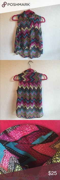 Romantic Sini zigzag Button down Blouse!! Romantic sini button down Blouse!! The tag has been removed at the top of the collar but other than that this piece is in great shape. Pair with jeans or shorts for a fun day out as the back falls farther than the front. Very light weight and see through so you'd want to wear something under it. :) Purple, green, and turquoise. :) Romantic Sini Tops Button Down Shirts