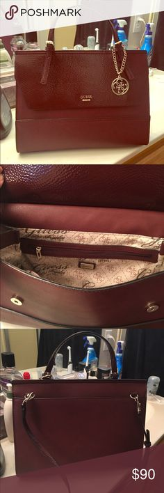 Brand new, 2016 season Maroon/Wine red Guess purse I really liked this purse but ended up buying a different one. Unfortunately I already took the tags off this one. New, in season, wine red Guess purse. Comes with shoulder strap. Make me an offer Guess Bags Totes