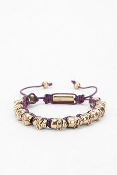 purple/gold skull bracelet