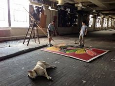 DOWNTOWN — Driving west on Congress out of the city, there's a can't-miss Blackhawks mural inside the broken-windowed, vacant Old Main Post Office. The four-paneled mural, held to the w…