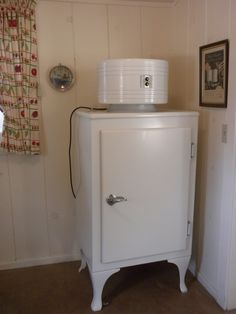 icebox have one at the house in Stuart it was my grandmothers and still works want to bring it up to my new house - I am retro-ing the kitchen with white cabinets, other white and black enamel items, table cabinet, rolling cart trying to decide on right type of drawer and cabinet pulls