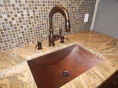 Copper and bronze for a wine cellar kitchen. Designer: Christine Janson