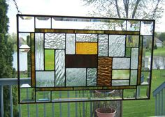 Stained glass window panel clear geometric abstract stained glass panel beveled green amber. $99.00, via Etsy.