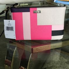 """🎉HP🆕 Kate Spade Color Block Party Lolly Wristlet BRAND NEW W/ TAGS. Kate Spade Lolly Wristlet in Brightwater Drive, Color Block Party. Multi-colored in soft pink, hot pink, black, purple, and navy. Kate Spade New York gold-toned hardware (with plastic sealed covering still in place). Saffiano textured grainy vinyl, adjustable wristlet strap (see last pic, to be worn in 2 different ways). Top zip closure with black interior of 4 credit card slip pockets. Approximate size: 5"""" (H) X 8"""" (W)…"""