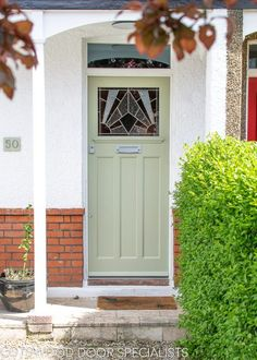 A striking stained glass 1930's front door with an Art Deco design. The stained glass is made with contrasting colours and textures of real glass. The different textures create a three dimensional piece, something that can only be created with real stained glass. The stained glass is then combined into a double glazed unit, so that it is warm and secure.