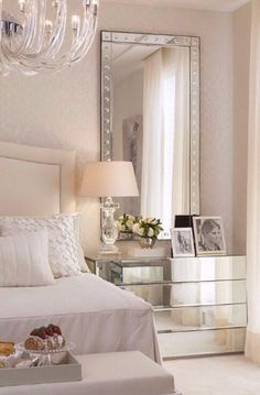White bedroom with mirrored furniture