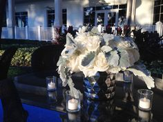 Mirrored vases with white roses are the perfect centerpiece to reflect the changing light at dusk for an evening reception. www.konceptevents.com