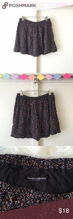 """Brandy Melville Black Floral Skater Skirt A staple mini skirt for summer! Black skater style with blue & pink floral pattern. Elastic waist: 26""""-34"""" / Length: 14.5"""" Brandy Melville Skirts Circle & Skater"""