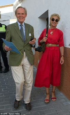 Proud parents: The Duke and Duchess of Wellington looked in fine spirits as they strolled around the quaint streets.