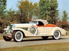 1933 Duesenberg SJ Roadster Cream & Orange.