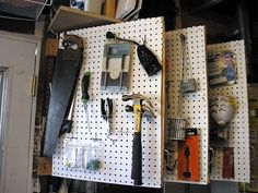 "a peg board ""book"" to hold hand tools.  What a great way to organize the garage.  Great tutorial too!"