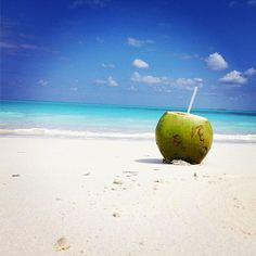 Enjoy some refreshing coconut water while relaxing on the beach!
