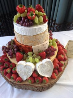 Four-tiered cheese wedding cake. Belton Farms Mature Cheddar, Redwood Smoked Cheddar & Wensleydale with Cranberry halves, Blue Stilton, and Creamy French Brie. Two Neufchatel brie hearts for decoration.