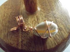 Loc jewelry with a wire wrapped cowrie shell charm by OutWord on Etsy