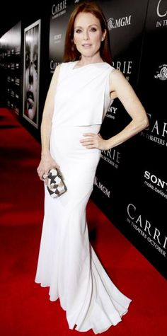 Look of the Day › October 8, 2013 WHAT SHE WORE At the Los Angeles premiere of Carrie, Julianne Moore stepped on the red carpet in a striking all-white draped Givenchy gown. A beaded Givenchy clutch and a huge diamond Harry Winston rock were the finishing touches.