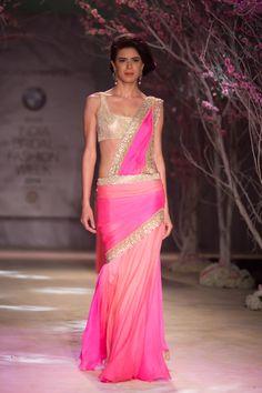 Pink and gold INdian wedding sari by Jyotsna Tiwari. More here: http://www.indianweddingsite.com/bmw-india-bridal-fashion-week-ibfw-2014-jyotsna-tiwari/