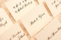 Escort card envelopes in Meant To Be Calligraphy's Miller lettering style via Simply Chic Events. Photo by Paul Morse Photographs