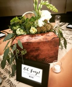 Custom made wood boxes with greenery for centerpieces. Simple, reusable, and beautiful.