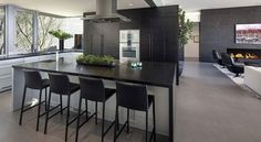 Home and Apartment: Sleek Kitchen Design With Dark Shelves In The Backdrop Also Dark Kitchen Island With Black Bar Stool Glass Window And White Kitchen Sets Also Ceiling Light: Elegant Contemporary Home with Lovely Laguna Beach Views
