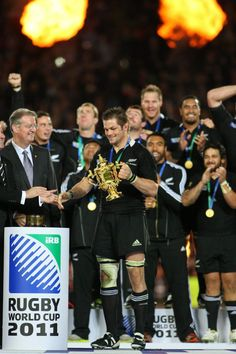 First RWC I watched on TV: Richie McCaw receives the trophy from Bernard Lapasset after the Final of the 2011 Rugby World Cup between the New Zealand All Blacks and France at Eden Park, Auckland on October 23, 2011.