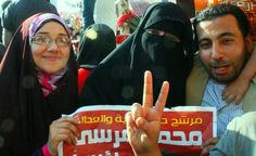 Holding a Morsi campaign poster at Tahrir Square via Pete Willows #Egypt