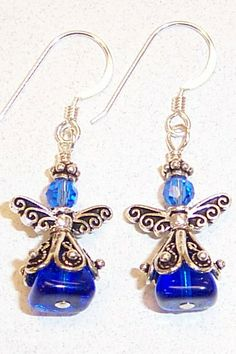 """My personal favorite of all Angel Earrings. Using glass beads, pewter wings and spacers, silver-filled headpins and ear wire. The special part is that she is wearing an expensive .925 sterling silver """"skirt""""! Original designed by Molly Mellor of BeadCircus, OH"""
