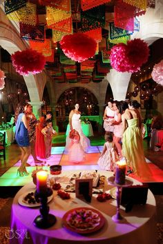 Wedding reception with traditional Mexican Flags and banners, traditional mexican decorations, hanging colorful flags and lots of traditional design.  Destination beach wedding at Dreams Riviera Cancun Resort and Spa