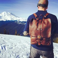 Simplicity is at its finest with the all-leather,Rainier Backpack.  Handcrafted withfive ounce kodiak oil tanned leather, this sturdy backpack  is ready for an adventure.Whether you're in the mountains or walking  aroundin the city, you'll be looking suave. It features two adjustable  back straps, and a double drawstring/flap closure.