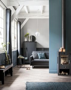 Love this look with the blue and grey paint colours. Simple stove looks great. Floor too pale for your house.