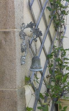 The doorbell outside rings and welcomes you into a French home. A warm sign of French country hospitality.