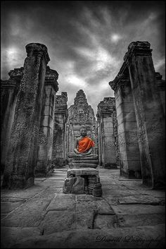 Divine, in orange ~ Angkor Thom Temple Complex, Angkor, Cambodia (by Darrell Neo on Flickr)