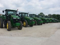Lineup of JOhn Deere row crop and 4WDs