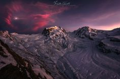Rose of the Alps - This is a shot of Mount Rosa (or Mont Rose, this explains the title) with his glacier seen from the Gornergrat observatory, at about 3100 m above the sea level, in Switzerland.  I took this picture at the late sunset lights, when the clouds surronded the moon that seemed like a little heart. I was very happy to explore these new places and to see these mountain landscapes full of snow.