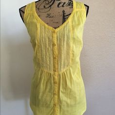 Yellow Top This is a yellow & white top from Lane Bryant, size 14. It is a sleeveless top with 4 buttons on chest. It is slightly sheer with square print. In excellent condition. Lane Bryant Tops