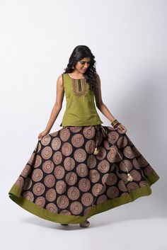 OLIVE GREEN KALAMKARI SKIRT SETS - Skirt in printed kalamkari cotton- Top in cross-grain handloom cotton- Black accent at armhole & neckline- Embroidery on front- Flared skirt with plain border- Separate attachable short sleeves provided Indian Skirt And Top, Skirt And Top Dress, Long Skirt And Top, Long Silk Skirt, Choli Designs, Sari Blouse Designs, Dress Neck Designs, Kurta Designs, Long Skirt Top Designs