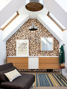 Made of wooden slices glued and nailed to a plywood backing, looks like stacked firewood, adding warm woodsy contrast to the rest of the room's white walls. - Dramatic Home Makeover - Country Living Fishing Shack, Log Wall, Wooden Slices, Bold Wallpaper, Piece A Vivre, Beautiful Bathrooms, Western Decor, White Walls, House Tours