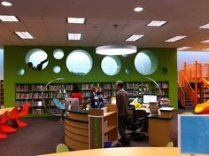COOLEST LIBRARY EVER!!!! Library has pods, bubble chairs... and a slide!