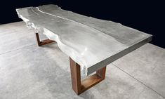 CAST ALUMINUM DINING TABLE (SANDCAST FROM A MULBERRY SLAB) WITH BLACK WALNUT SLAB CURTAIN LEGS