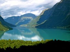 Loenvatn Lake, Lodalen Valley, Norway - The Kjenndalen Valley & the Kjenndalen Glacier lie at the end of Lodal valley, 17 km from Loen. Twice in this century, huge blocks of stone fell from the sides of Mt. Ramnefjell into the Lovatn lake below. The resulting tidal waves decimated the hamlets of Nesdal and Bødal. The years 1905 and 1936 will forever remind people of Inner Nordfjord of the Lodal Valley catastrophes.