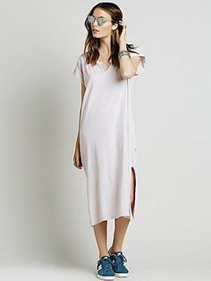 Easy Knit Dress | Super easy and effortless midi cotton t-shirt dress featuring a V-Neckline with raw trim.  Side vents and cuffed sleeves.   *By NYTT ** Please reference the conversion chart below to find your size:  Size 0 = Extra Small  Size 1 = Small  Size 2 = Medium  Size 3 = Large