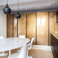 Metal covering - Isabelle Stanislas - Decorative metal panelling of kitchen doors - Paris - Pouenat Ferronnier