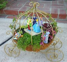 Miniature Fairy Garden - CINDERELLA in the gold pumpkin carriage dancing with Prince Charming at the ball; CINDERELLA'S fairy godmother and her mice friends, Jaq and Gus. Lady Tremaine, Anastasia, and Drizella do not appear to be very happy. 8/2015