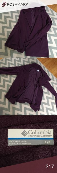 Columbia button front wrap in plum Cozy wrap from Columbia in a deep plum color.  Size small and in excellent condition. This wrap has a two button collar closure and is perfect for curling up next to the fire with a good book! 💜 Columbia Tops Sweatshirts & Hoodies