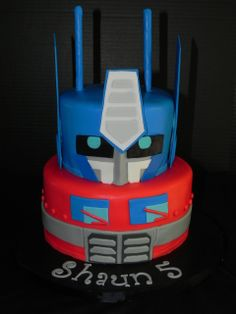 Optimus Prime Transformer Cake - vanilla cake w/chocolate filling and marble cake w/cookies and cream filling all iced in BC and covered in fondant. Everything Edible! Fourth Birthday, Mickey Birthday, Birthday Ideas, Optimus Prime, Transformers Optimus, Custom Birthday Cakes, Custom Cakes, Transformer Birthday, Transformer Cake