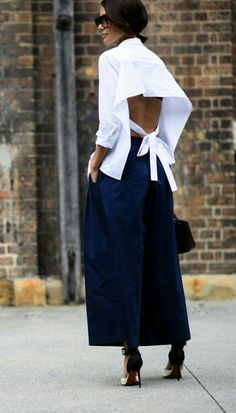 Elegant spring look with open back white shirt, wide leg pants and strap sandals.