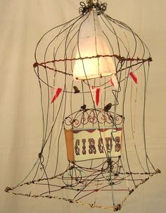 This wire circus sculpture draws a clever, bird, parallel. One watches birds and one watches a circus...