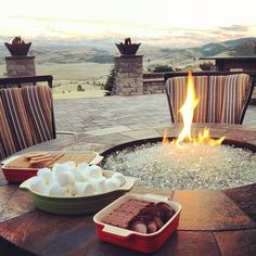 Cool view, cool fire, and REESE PEANUT BUTTER CUPS for the chocolate in their s'mores what a brilliant idea!!!