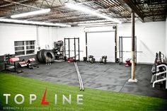 This is how Top Line Gym looked the first month we opened in October 2011.  This was all we had, 2 racks, 2 bars and really big goals.  It's nice to look back and remember the progressions we went through during our growth as a gym, business and entourage.  If you have a dream of owning a gym try this: start small, think big, solve problems and always focus on your people first.