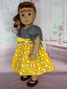Maryellen is wearing a retro style dress that is typical of the styles of the 50s. I used a black and white gingham check for the bodice. It has gathered sleeves with elastic casing and closes in the back with working buttons and buttonholes . I added two rows of yellow bias tape and a